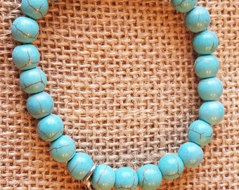 Southwest chic natural turquoise stone bracelet with silver feather charm