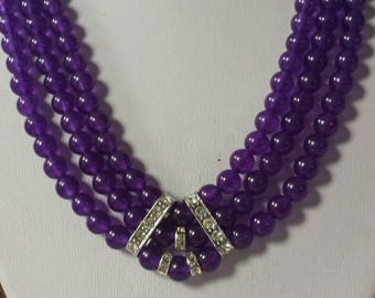 Gorgeous three rows of natural Amethyst stones with touches of diamonds of course!