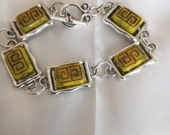 Silvertone link bracelet with pineapple colored glass beads with tribal markings and lovely toggle- 7 inches