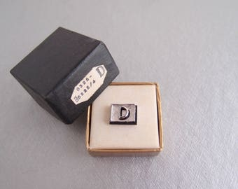 D is for __  1940s 1950s New Old Stock inital letter D tie tack pin in original box / shiny and textured silver edged in black