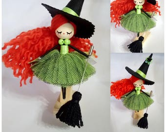 Brooch witch doll made and painted manually.