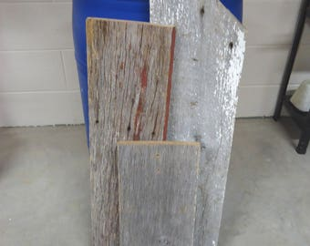 Reclaimed antique old barn wood, one with red paint, one with white paint, one weathered gray