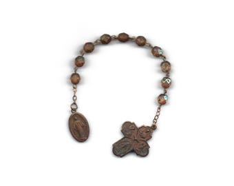 Antique Miraculous Medal chaplet found at the site of a church fire at a ghost town in Kansas