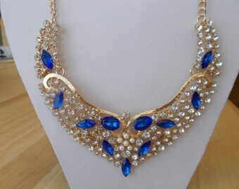 Gold Tone Bib Necklace with Blue and Clear Crystals and Rhinestones on a Gold Tone Chain