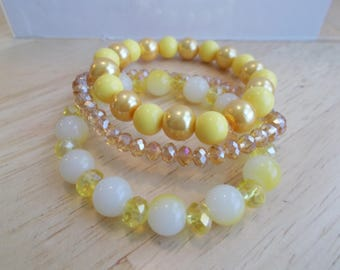 3 Stretch Bracelets made with Yellow and Gold Crystal Beads, Gold Pearls, White and Yellow Glass Beads