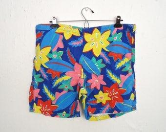 1980s Flower Pattern Shorts / vintage Arrow Hawaiian drawstring board shorts / blue pink yellow red floral summer trunks / men's medium