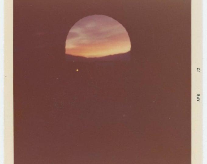 Vintage Snapshot Photo: Sunrise Through Arch, 1972 (710613)