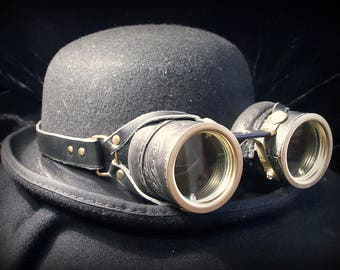 Steampunk goggles in black leather with gold embossed decoration