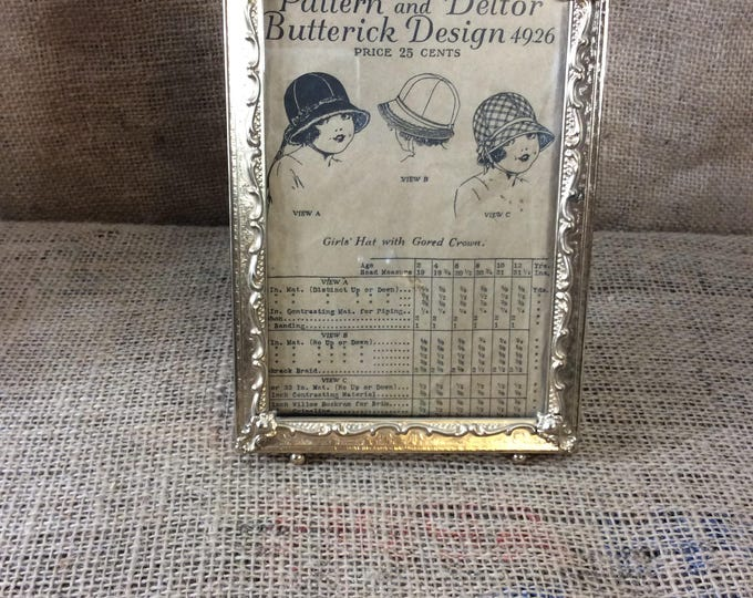 Vintage gold picture frame with antique little girls sewing pattern, Butterick pattern from 1919, with gold picture frame from mid century
