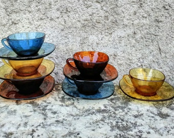 Six French 'vereco' blue brown and amber, glass coffee/espresso/tea cups and saucers