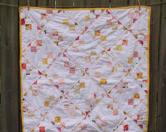 pink and yellow pinwheel quilt