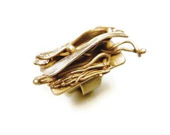 Bague en bronze doré mouvement plissé