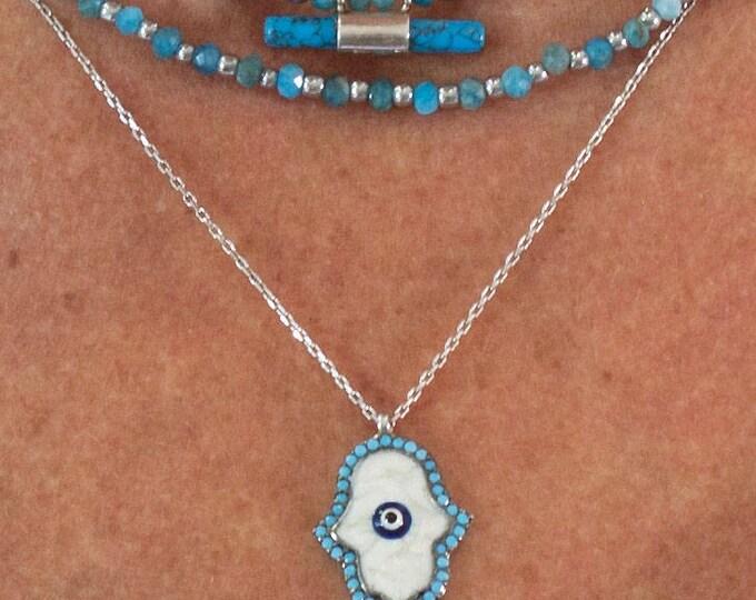 a hand of Fatima pendant necklace