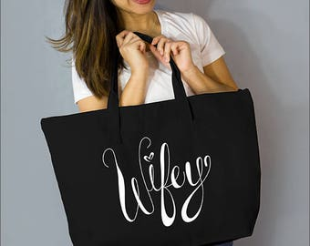 "White Ink Wifey Large Zip Tote: 100% Black Natural Cotton Canvas 22""W x 15""L x 5""D with Interior Zippered Pocket and Bottom Gusset- Ellafly"