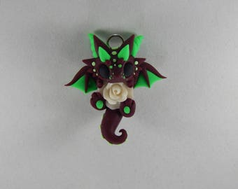 Maroon Dragon Holding a White Rose Necklace