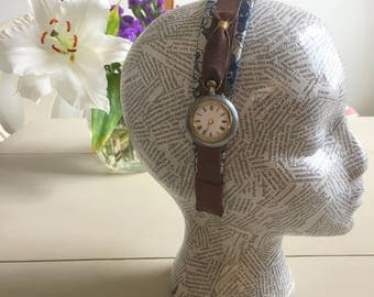 a silk and lace headband with antique pocket watch