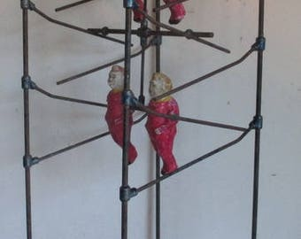 antique French toy  circus acrobats climbing on a rack