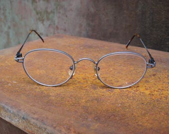 1990s French Round Eyeglasses. Pewter metal frames, tortoiseshell plastic ear pieces. Yuppy style. Immaculate condition. Made in France.