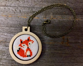 Fox cross stitch pendant necklace on bronze chain in laser cut wood hoop by Canadian Stitchery