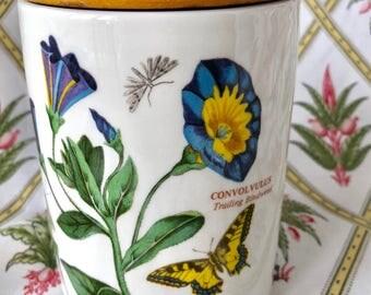 A pretty vintage Portmeirion Botanic Garden 5.5 Inch airtight storage jar featuring Convolvulus, Designed By Susan Williams-Ellis. c1970s.