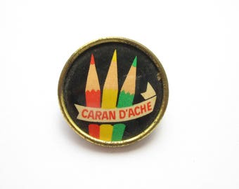 Cute vintage button with 3 colored pencils, red yellow and green crayon of Caran d'Ache, vintage pinback button