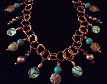 Turquoise Abalone Copper necklace, with crystal and copper accents. Copper Chain adjusts approximately 18 to 20 inches.