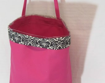 Pink fabric Garby with clear plastic interior to hold all the trash in your car