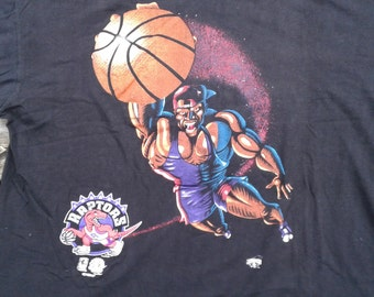 Vintage 90's 1994 Toronto Raptors t-shirt Made in Canada by Ravens Athletics