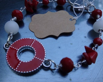 red and white glass  beaded bracelet with red charm