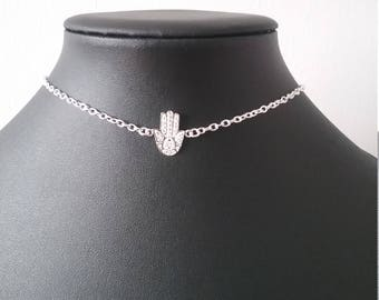 Silver choker with sterling silver hamsa charm.
