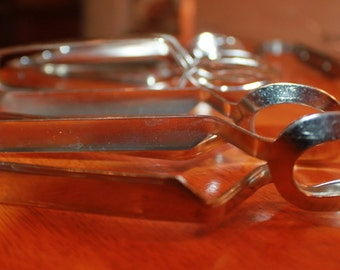 7 Vintage Escargot Clamps, forks and tongs