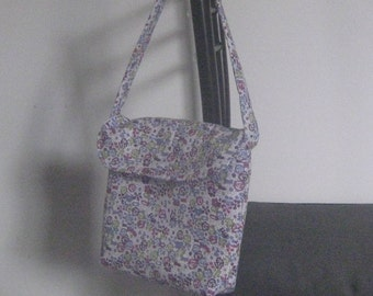 small handbag with zipper pouch inside