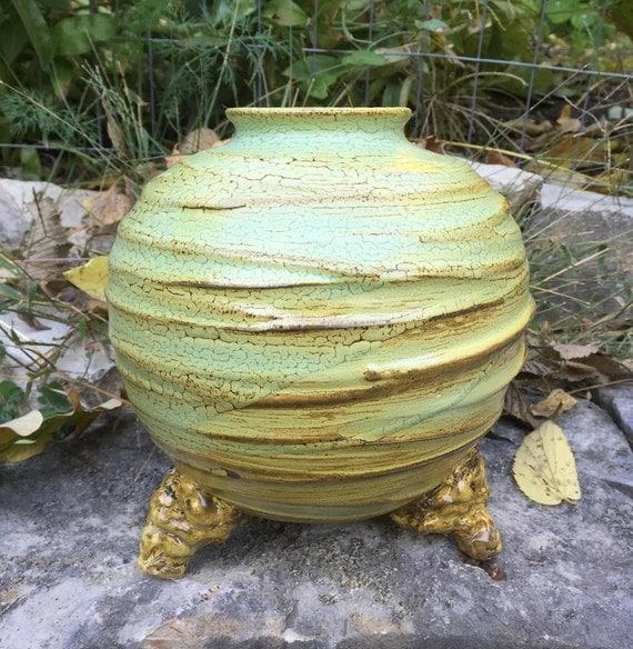 medium sized porcelain vase in pale green and golden beige