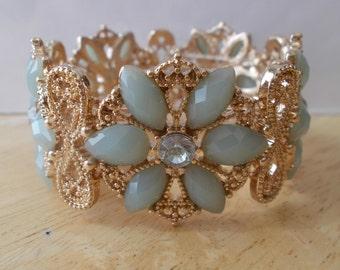Gold Tone Stretch Cuff Bracelet with Aqua Bead Flowers and Clear Rhinestones