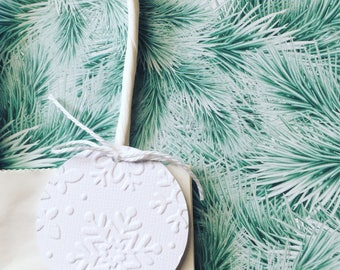 Snowflake embossed gift tags. Round gift tags, swing tags. Gifts, favors. Christmas wrapping, Birthday party, Xmas gifts, White snowflakes.