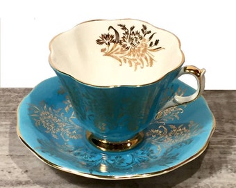 Queen Anne Tea Cup and Saucer Blue Tea cup Turquoise Teacup Gold Scroll Gold Footing Fluted Tea cup Vintage Bone China England Pattern 304