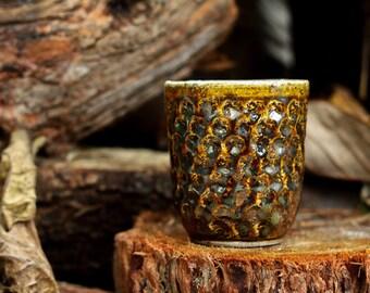 Stoneware Cup with peach stone imprints in fluid woodash glaze