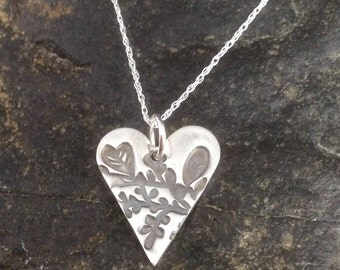Fine silver heart necklace with leaves pattern