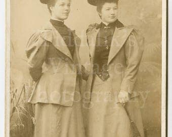 Cabinet Card Photo - Victorian Two Young Pretty Slim Women, Puff Sleeve Jackets, Big Hats, Wasp Waist Portrait - Lombardi & Co. of London