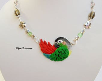 Green cheek conure  necklace, hand sculpted, polymer clay parrot.