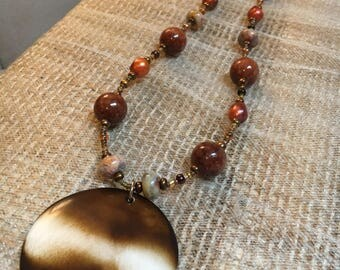 Beaded stone and burnt orange necklace with faux wood pendant