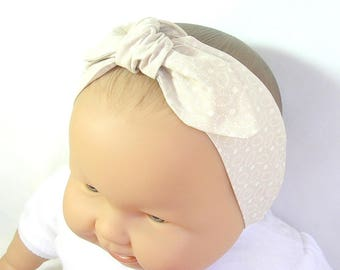 White and beige baby headband, elastic at the back, ajustable with the knot