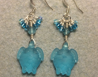 Turquoise sea glass sea turtle bead earrings adorned with turquoise Czech glass beads and tiny dangling turquoise Czech glass beads.