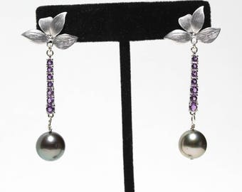 Purple amethysts set in 14K white gold with 10mm black round pearl earrings