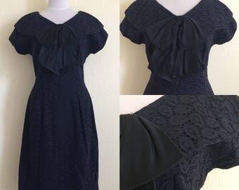 1950s - 1960s black eyelet dress with satiny bow!