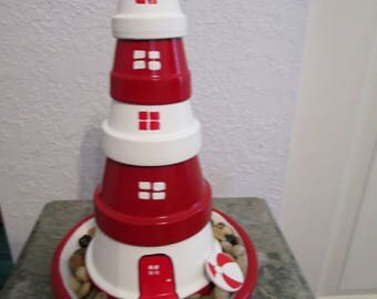 """10 1/2"""" Hand Painted Clay Pot Lighthouse"""
