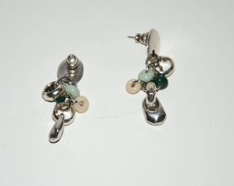 A pair of zamak earrings with aqua,cream,dark green lamp work beads,connected by thick silver filled jump rings.