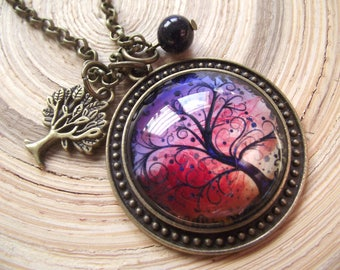 Long necklace with glass cabochon motif of tree of life tree