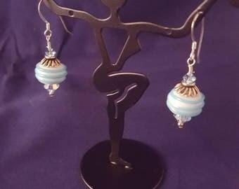 White bead with light blue swirl