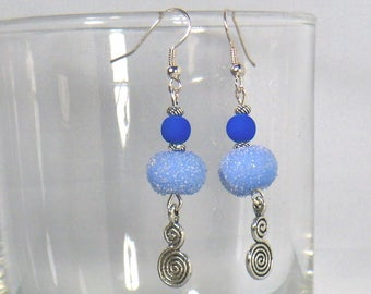 pair of earrings with two blue spirals